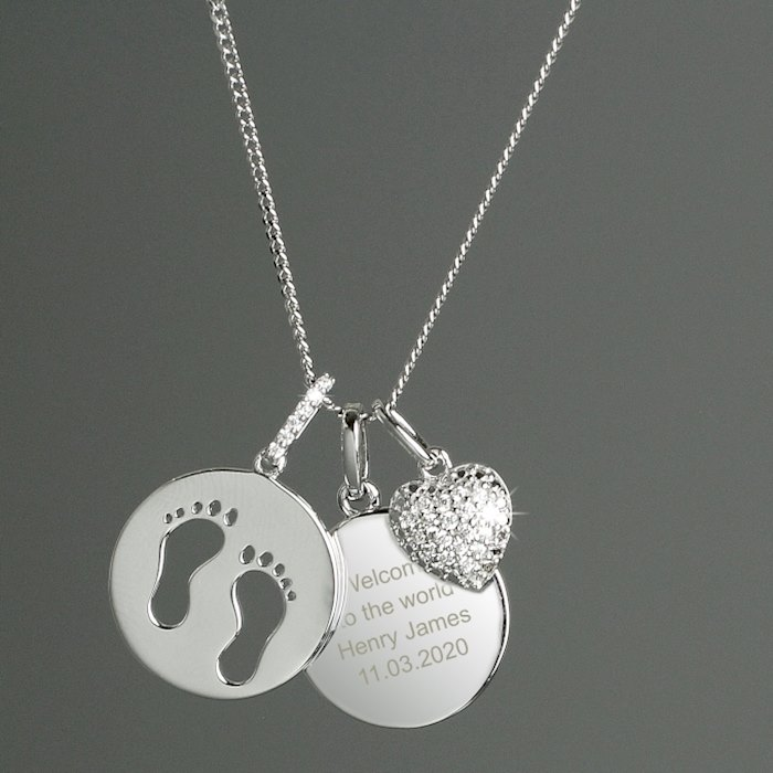 Sterling Silver Footprints and Cubic Zirconia Heart Necklace